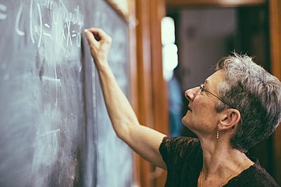 Women, Teacher, Writing on Chalk Board